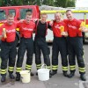 Westbury firefighters' car wash raises buckets for charity