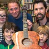 £10,000 – and rising: Guitar signed by world-famous musicians raises over £10k