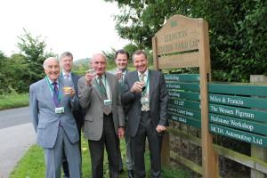 Directors celebrate the anniversary at the entrance to Edington Station Yard