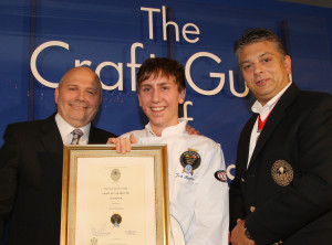 Josh receives his certificate from the competition