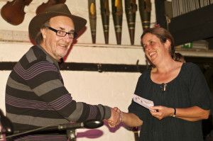 Gerry Cooper presents competition winner Angie Hulin with her prize