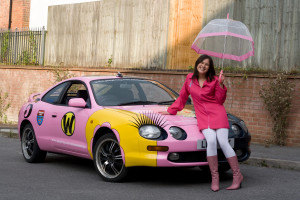 Natasha Penny dressed as Penelope Pitstop and her car decorated in the style of 1960s cartoon Wacky Races