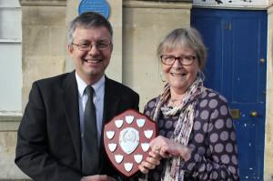 Erica Watson receives the award from White Horse News editor, Ian Drew